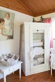 White linen cupboard with transparent mesh door in corner