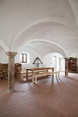 Cross-vaults, pillars and brick floor in dining room