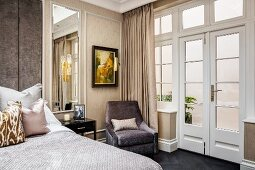 Glamorous bedroom in warm shades with lattice French windows