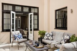 Comfortable seating area on terrace outside house