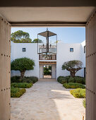 View into Mediterranean courtyard through open doors