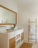 Masonry washstand with wooden doors in natural bathroom