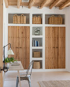 Masonry cupboards and shelves with wooden doors and baskets
