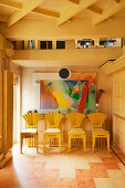 Designer sunburst chairs and modern painting in hallway