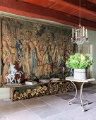 17th-century Flemish tapestry, wooden bench and table under French 19th-century glass chandelier
