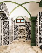 Vaulted ceiling, green column and Baroque, black and white wallpaper in hallway