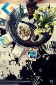 View from above on coffee table with daffodils and book stacks