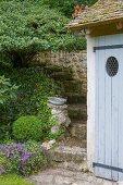 Vintage garden steps next to wooden door