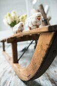 Sheep ornaments on rustic wooden sledge