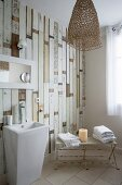 Wall made from reclaimed wooden boards in vintage bathroom