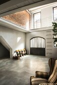 Concrete floor in bright foyer of loft apartment