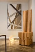 Modern wooden throne in front of cord artwork
