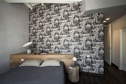 Custom-made headboard against partition wall in elegant bedroom in shades of grey