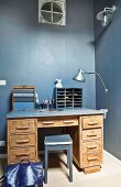 Desk against grey-blue wall