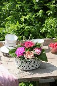 Arrangement of carnations in lacy basket