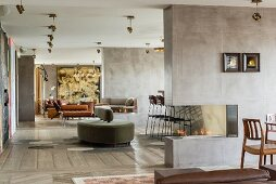Retro velvet sofa and fireplace in concrete wall