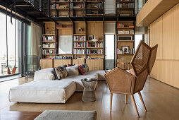 Double-height interior and gallery in modern, architect-designed house