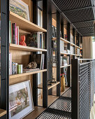 Bookcases on gallery made from black wire mesh