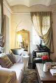 Curtains draped over piping in cosy living room