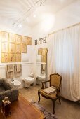 Baroque chair, gallery of pictures and full-length mirror in bathroom in natural shades