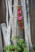 Garland of threaded autumn leaves and flowers