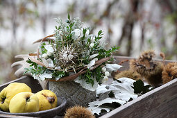 Arrangement of box, thistles and honesty in wooden crate