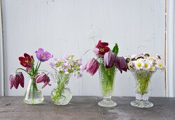 Various wildflowers in vintage-style vases
