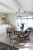 Drop-leaf table in bright dining area in front of kitchen counter