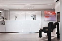 White island counter and black designer chair