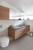 Bright bathroom with white tiles and fitted furnishings