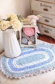 Crocheted, oval, rag-yarn rug in shades of blue