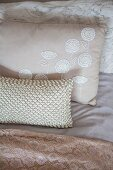 Various cushions and textiles in Champagne hues