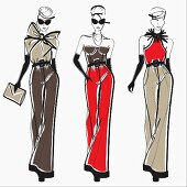Three elegant fashion models side by side approaching camera wearing pants
