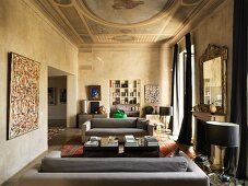 Old ceiling fresco and modern furniture in living room