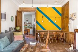 Brightly coloured wall and wood panelling in living room