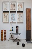 Framed leaves on wall, wooden artworks and metal side tables