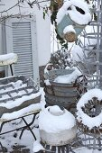 Collection of zinc objects in snowy garden
