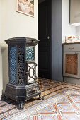 Antique, artistic, cast iron stove on patterned tiles