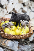 Hand-made, needle-felted, woollen wild boar in basket of quinces