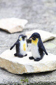 Two hand-made, felted, woollen penguins