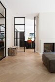 Steel and glass double doors between living room and kitchen
