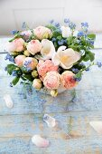 Spring bouquet with forget-me-nots on blue wooden boards