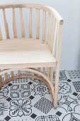 Semicircular chair on tiled floor with black and white pattern