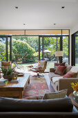 Living room in natural tones with an open window to the garden