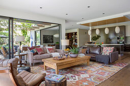 Open living room in natural tones with a window facing the garden