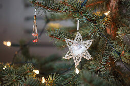 Vintage-style decoration and fairy lights on Christmas tree