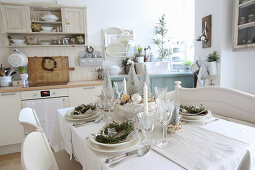 Festively set table in kitchen decorated for Christmas