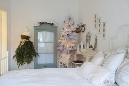 Christmas decorations in white vintage-style bedroom