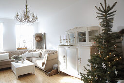 Christmas tree and old dresser in cream living room