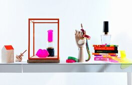 Still-life arrangement of neon accessories and books
